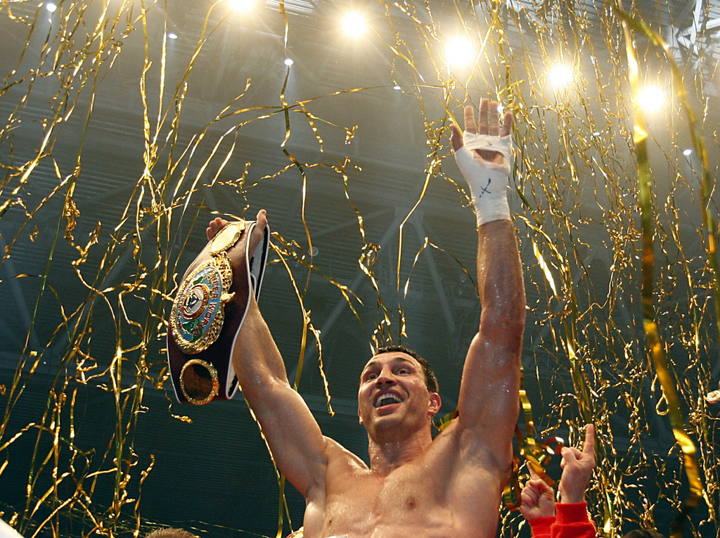 FILE - In this March 20, 2010 file photo, Ukrainian champion Wladimir Klitschko reacts after winning the  IBF, WBO and IBO heavyweight boxing title ma...