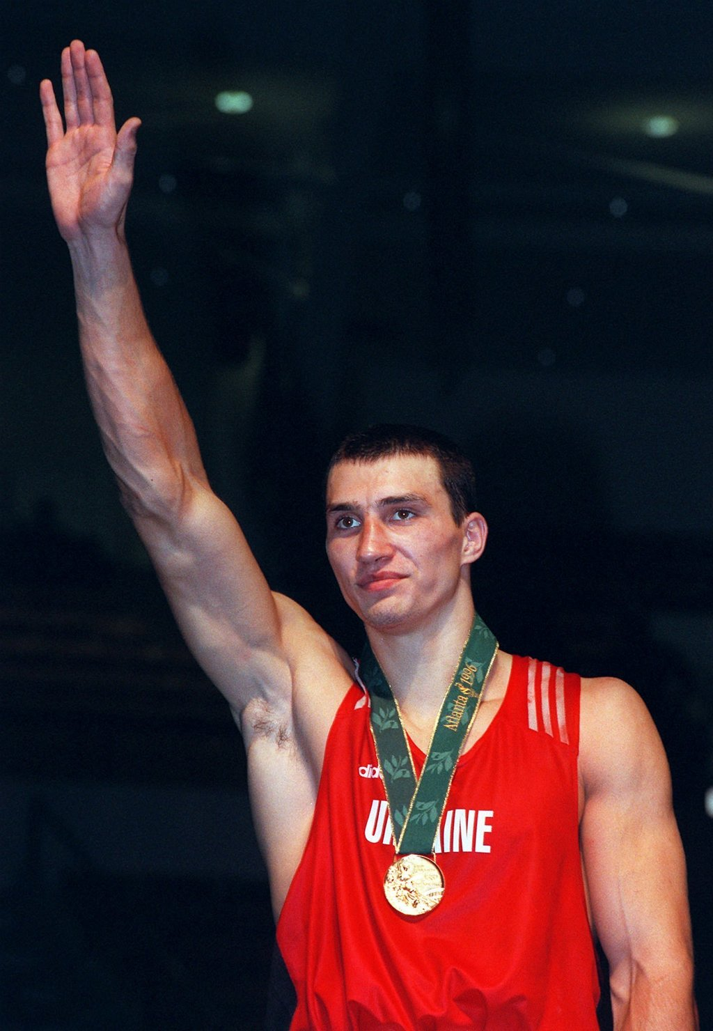 FILE - In this April 8, 1996 file photo Ukrainian boxer Wladimir Klitschko poses with his gold medal at the 1996 Atlanta Olympic Games. Former heavywe...