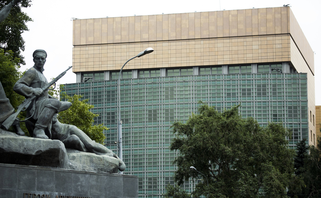 FILE - In this July 28, 2017, file photo, the U.S. Embassy in Moscow, with a monument to Russian revolutionary workers in the foreground. President Do...