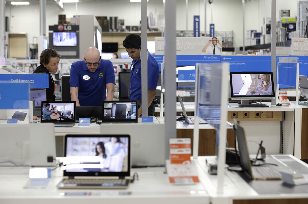 In this Tuesday, May 23, 2017, photo, employees assist a customer with a computer at Best Buy in Cary, N.C. On Thursday, Aug. 3, 2017, the Institute f...