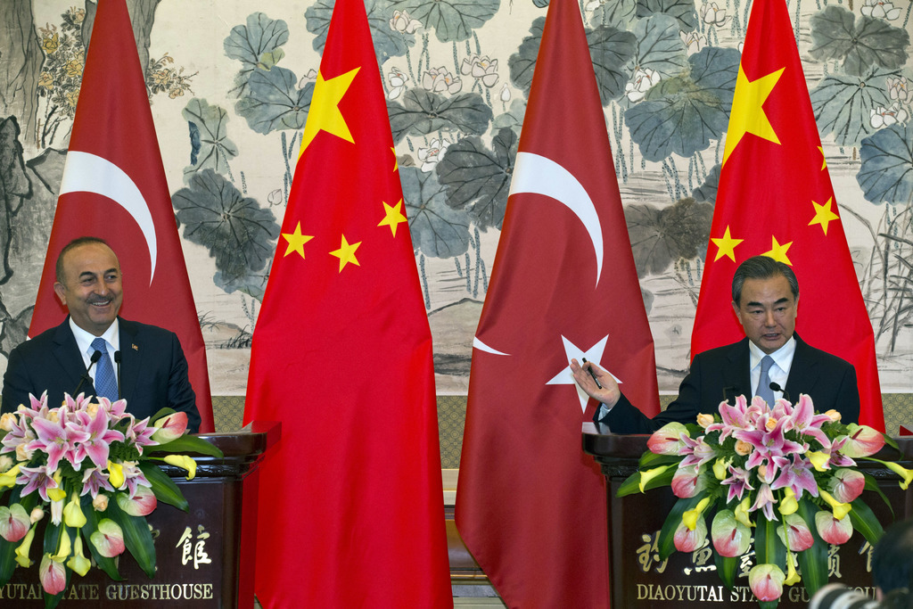 Chinese Foreign Minister Wang Yi, right, and Turkish Foreign Minister Mevlut Cavusoglu attend a joint press conference at the Diaoyutai State Guesthou...