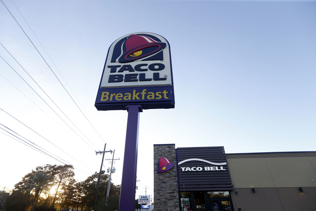 FILE - This Thursday, Dec. 15, 2016, file photo shows a Taco Bell restaurant in Metairie, La. Yum Brands, Inc., which operates Taco Bell, KFC and Pizz...