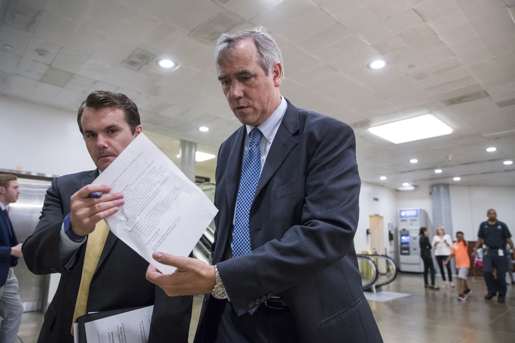 Sen. Jeff Merkley, D-Ore., and other members of the Senate Foreign Relations Committee, arrive on Capitol Hill Washington, Wednesday, Aug. 2, 2017, fo...
