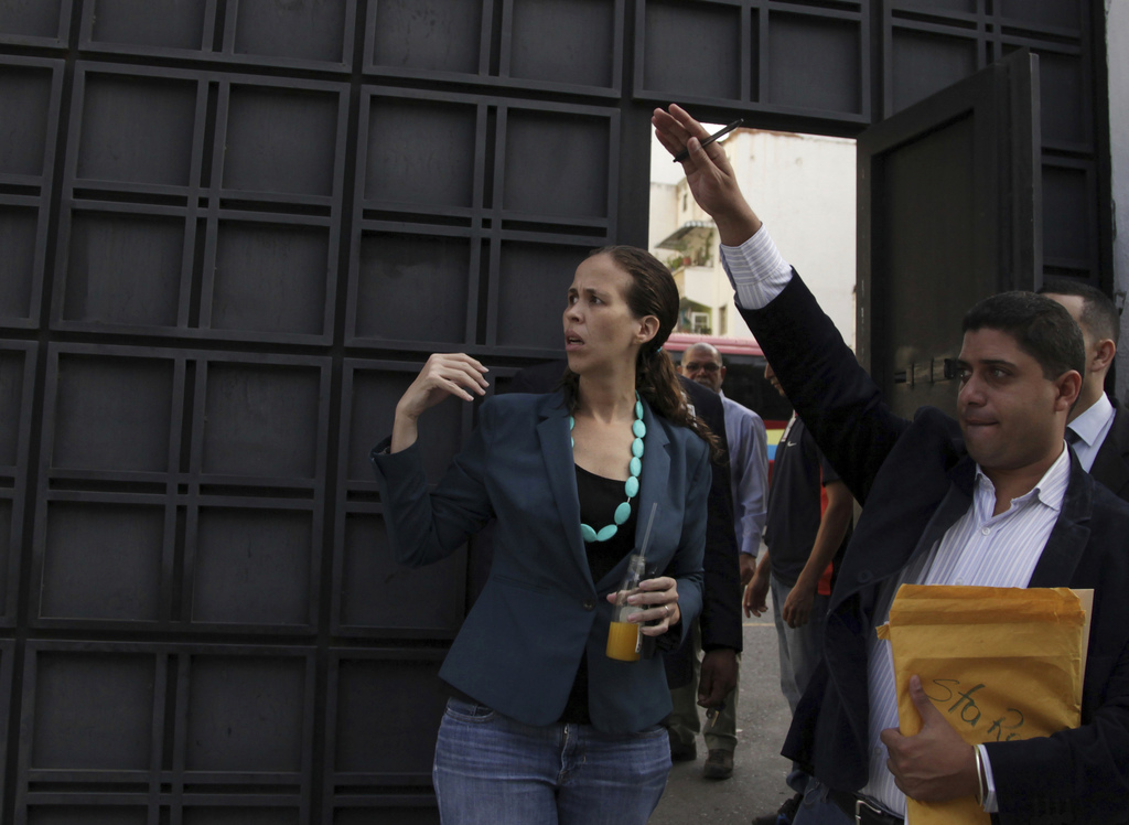 Opposition lawmakers Manuela Bolivar, left, enters the Venezuelan General Prosecutor's office to introduce a petition asking for an investigation into...