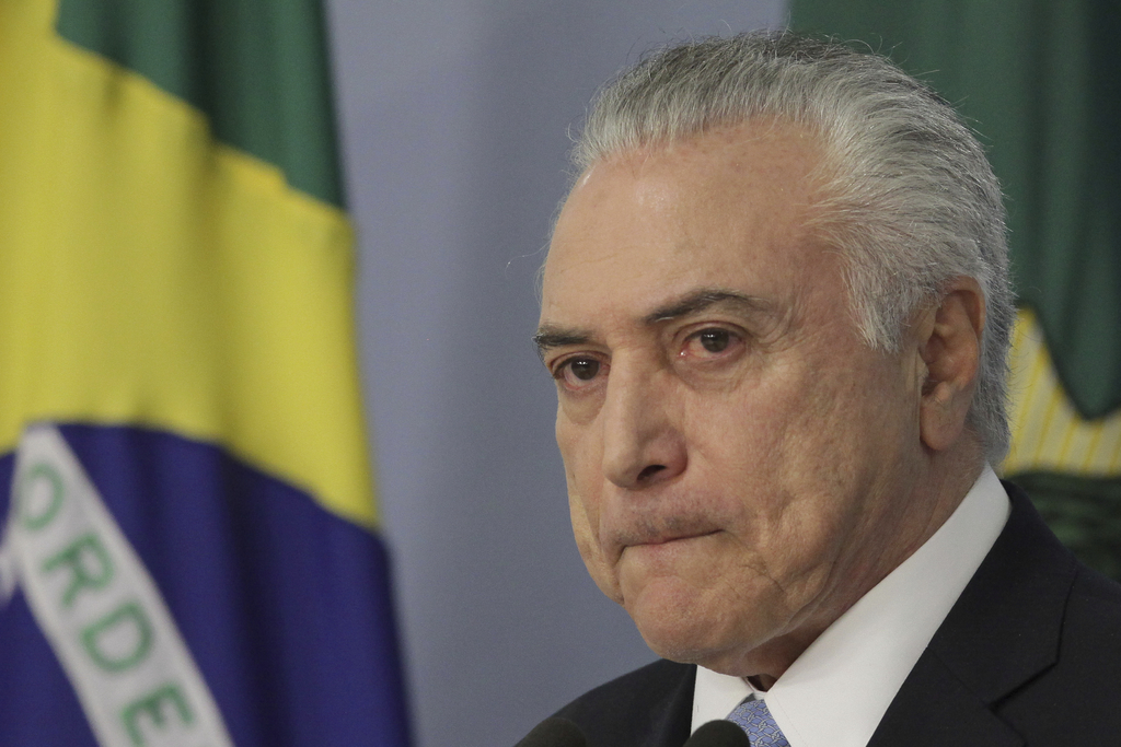 Brazil's President Michel Temer gives a statement at Planalto presidential palace in Brasilia, Brazil, Wednesday, Aug. 2, 2017, after surviving a key ...