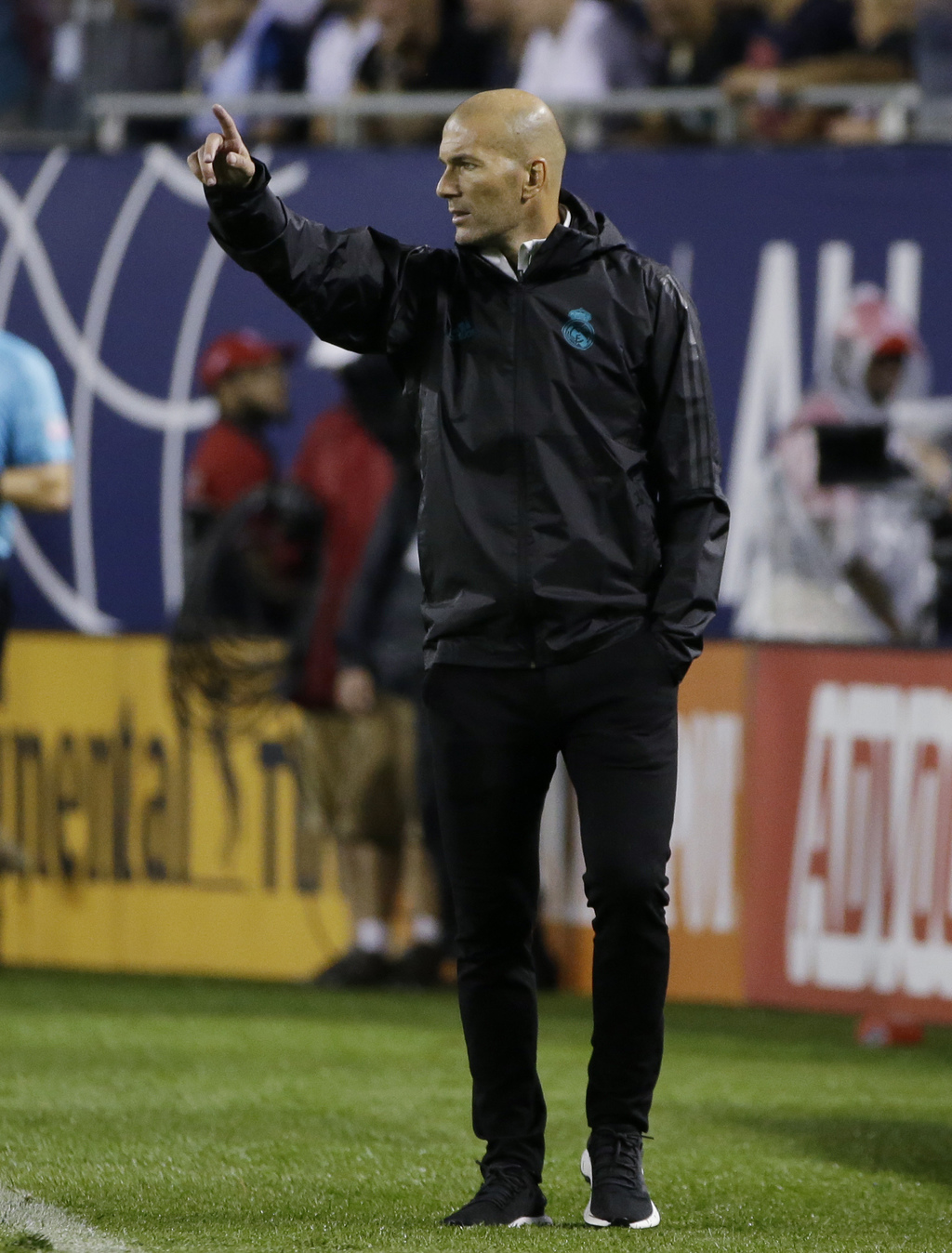 Real Madrid coach Zinedine Zidane points as he talks to his players during the first half of the MLS All-Star Game against the MLS All-Stars, Wednesda...