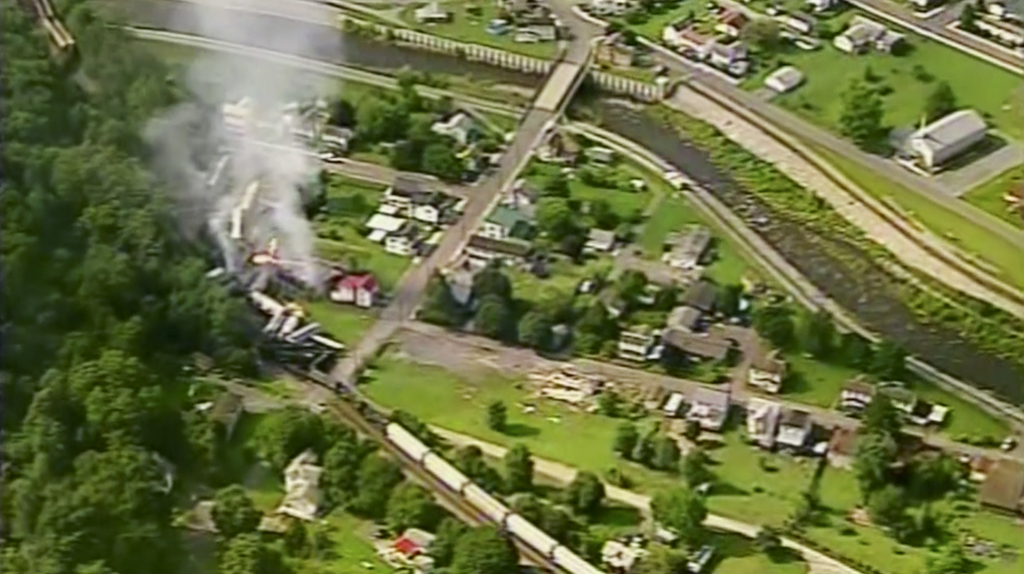 In this aerial image made from a video provided by WPXI, smoke rises into the air after dozens of cars of a freight train carrying hazardous materials...