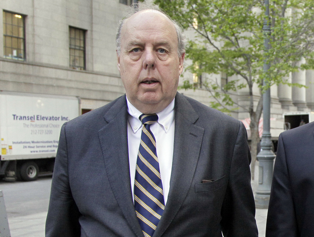 FILE - In this April 29, 20111, file photo, Attorney John Dowd walks in New York. Down, one of the key lawyers in President Donald Trump's corner navi...