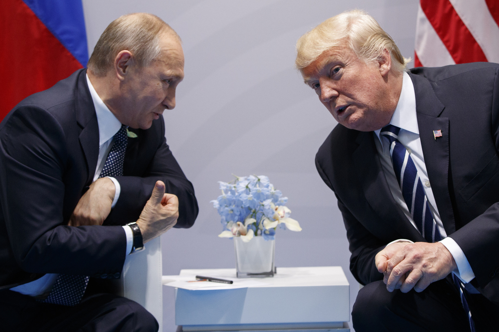 FILE - In this July 7, 2017, file photo, President Donald Trump meets with Russian President Vladimir Putin at the G-20 Summit in Hamburg. Trump signe...