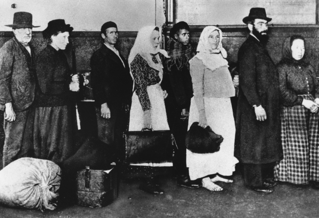 FILE - In this undated photo of a group of immigrants, who arrived at Ellis Island in New York, wait in line to begin immigration proceedings. Senior ...