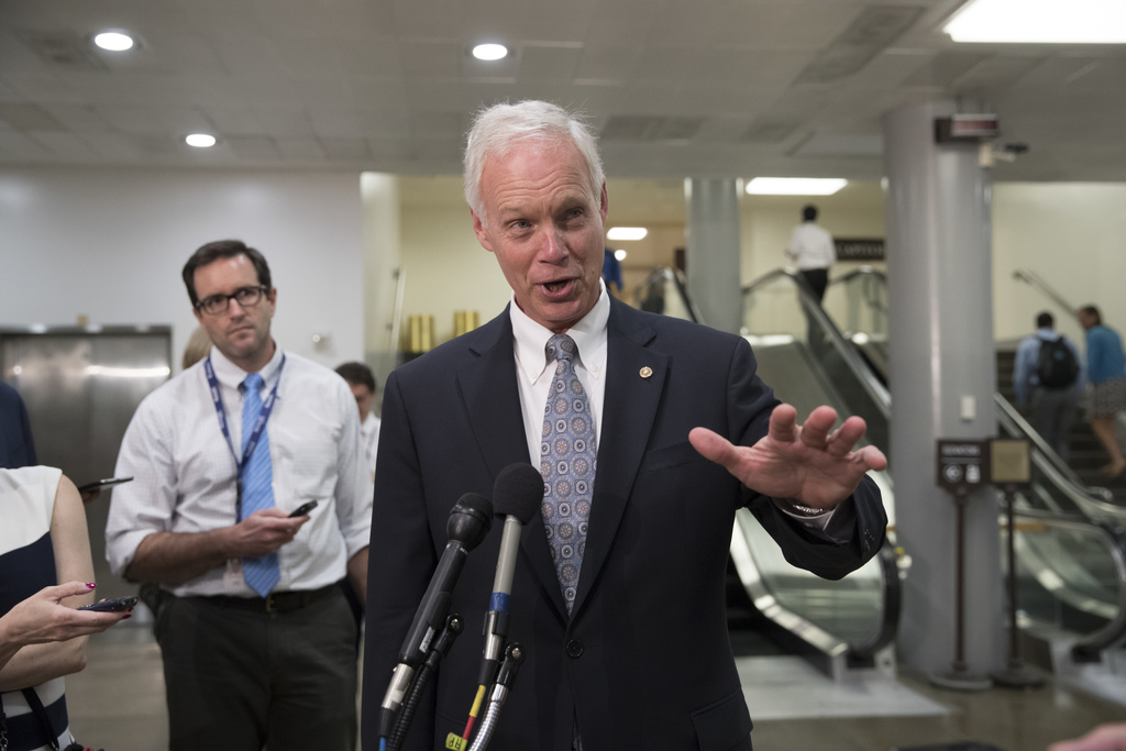 Senate Foreign Relations Committee member Sen. Ron Johnson, R-Wis. talks to reporters on Capitol Hill Washington, Wednesday, Aug. 2, 2017, following a...