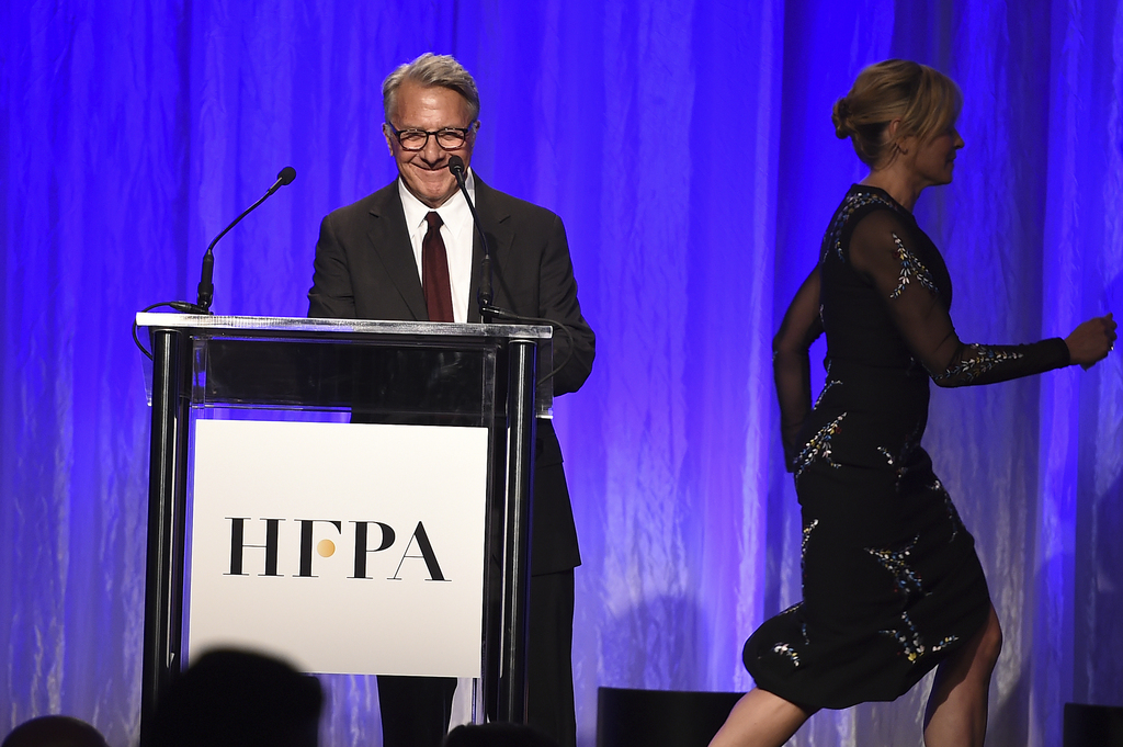 Dustin Hoffman speaks at the Hollywood Foreign Press Association Grants Banquet as Chelsea Handler leaves the stage at the Beverly Wilshire Hotel on W...