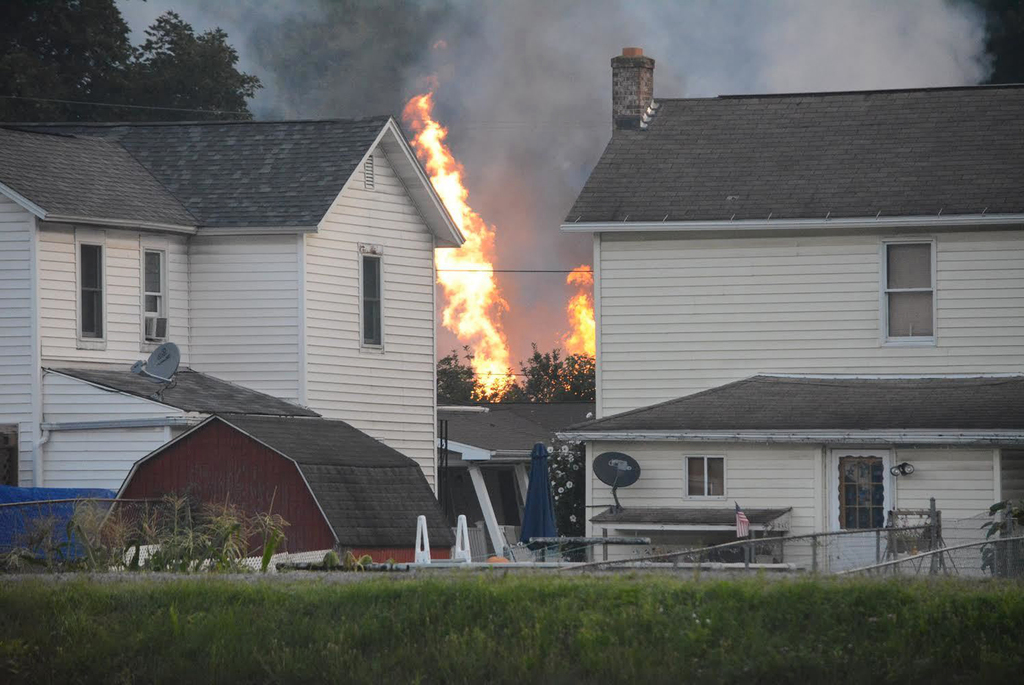 A fire burns at the site of a freight train derailment, Wednesday, Aug. 2, 2017, in Hyndman, Pa. A freight train carrying hazardous materials partly d...