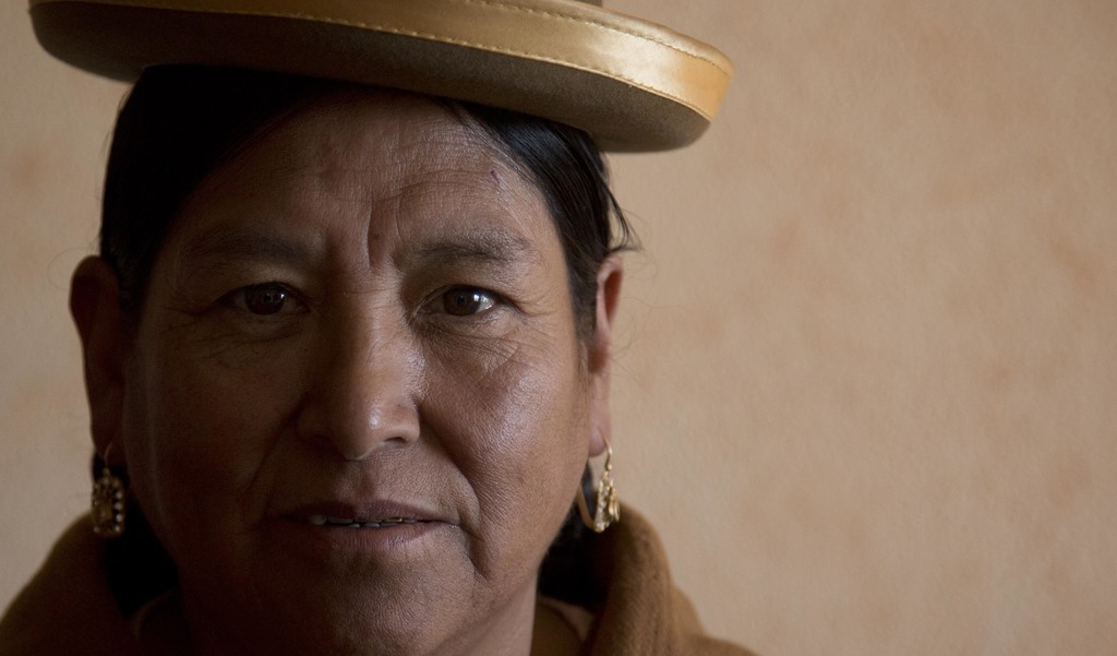In this July 20, 2017 photo, midwife Ana Choque poses for a portrait before leaving her home to visit a pregnant patient for prenatal care in El Alto,...