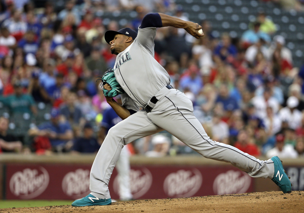 Seattle Mariners starting pitcher Ariel Miranda throws to a Texas Rangers batter during the fourth inning of a baseball game, Wednesday, Aug. 2, 2017,...