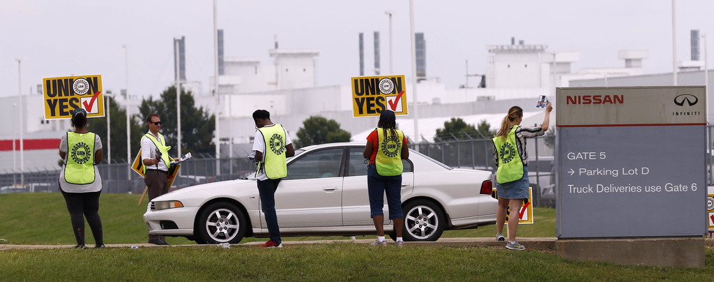 In this Tuesday, Aug. 1, 2017, photo, UAW members set up an informational line outside an employee entrance at the Nissan vehicle assembly plant in Ca...