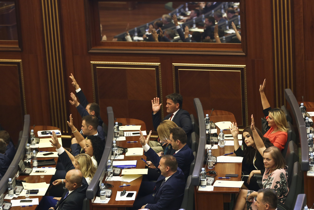 Kosovo opposition lawmakers vote during a parliamentary session where lawmakers of the winning coalition failed to choose a new speaker amid doubts if...