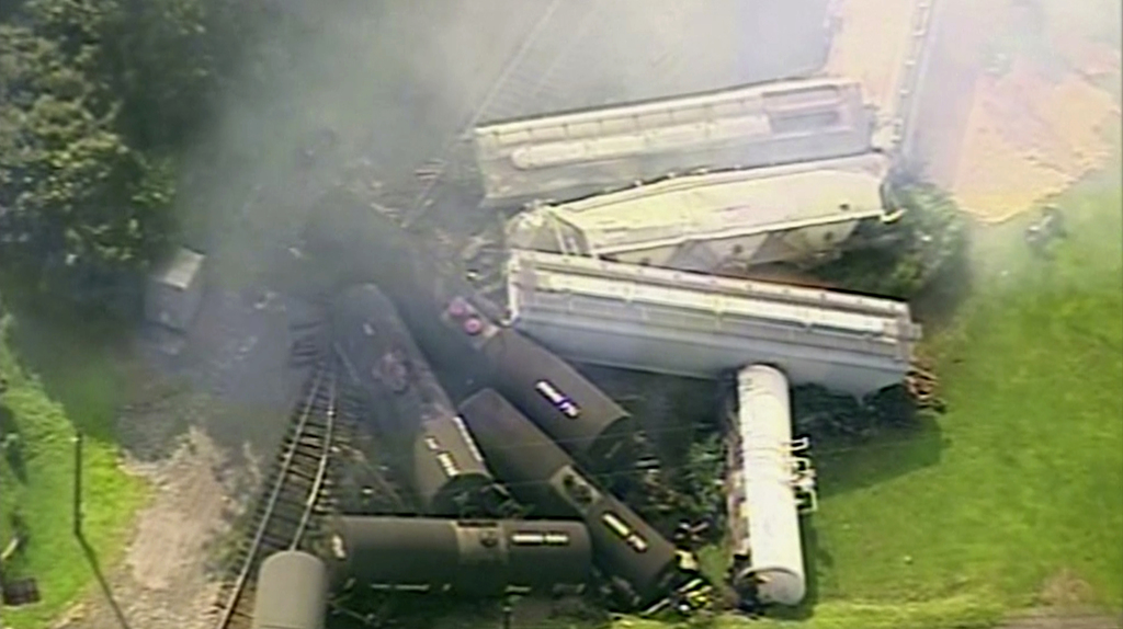 In this aerial image made from a video provided by WPXI, smoke rises in the air after dozens of cars of a freight train carrying hazardous materials d...