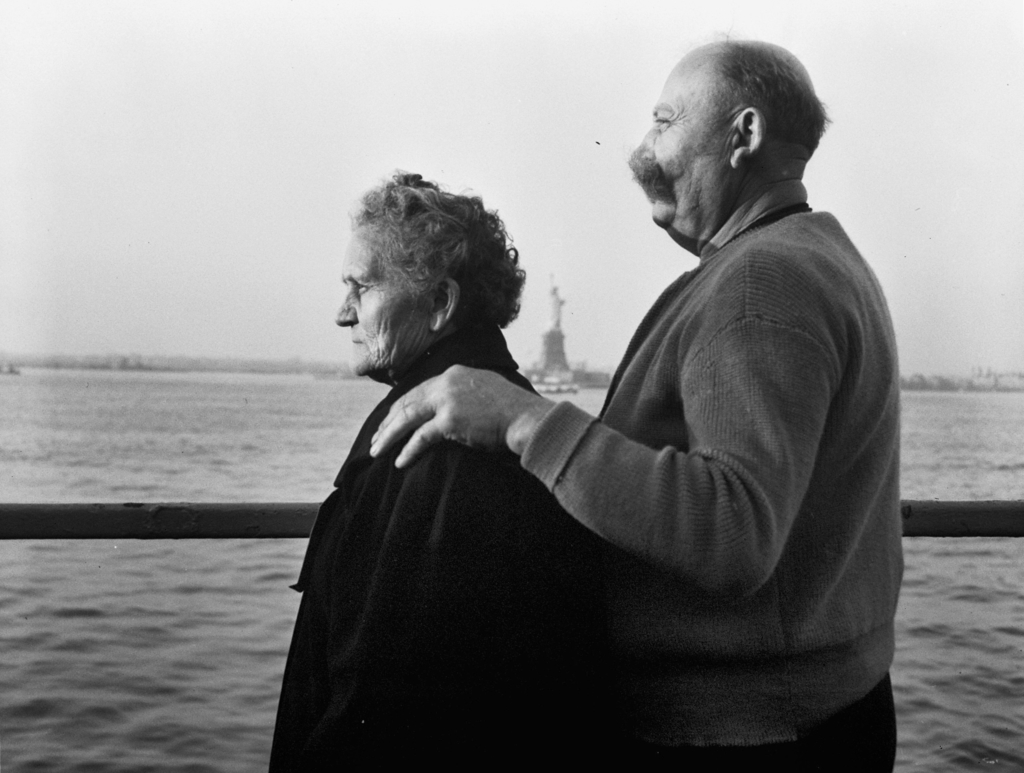 FILE - In this Oct. 28, 1956 file photo, Mr. and Mrs. Paul Roerich from Bavaria, Germany, look out from the stern of the USNS General Langfitt anchore...