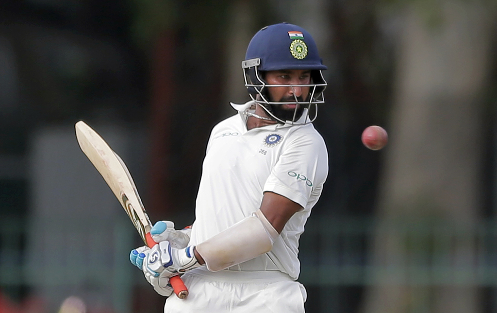 India's Cheteshwar Pujara eyes the ball before playing a shot during their second cricket test match against Sri Lanka in Colombo, Sri Lanka, Thursday...