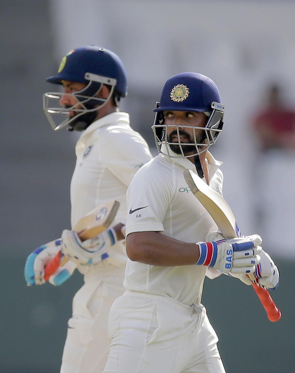 India's Cheteshwar Pujara, left, and Ajinkya Rahane run between the wickets during their second cricket test match against Sri Lanka in Colombo, Sri L...