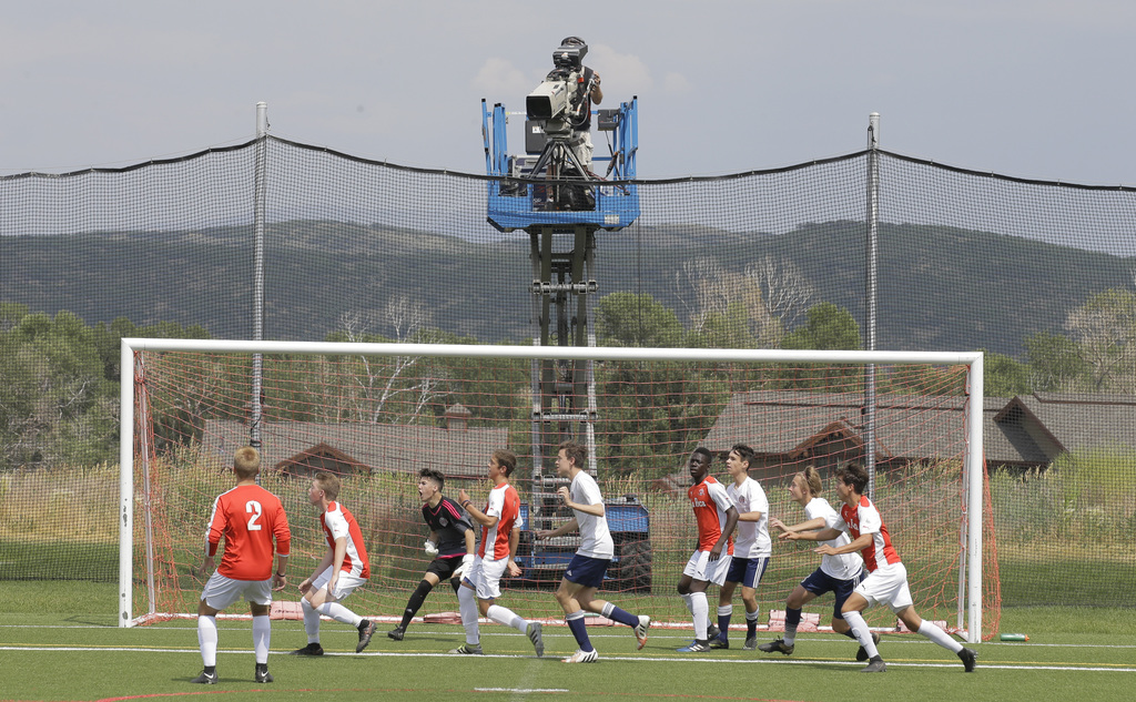 In this July 11, 2017, photo, a camera filming play during a MLS video replay scrimmage organized in a community park, in Park City, Utah. The games w...