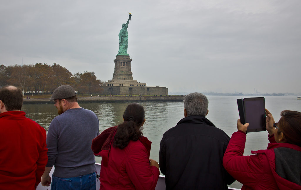 FILE - In this Nov. 5, 2015, file photo, visitors view the Statue of Liberty during a ferry ride to Liberty Island in New York. Senior White House aid...