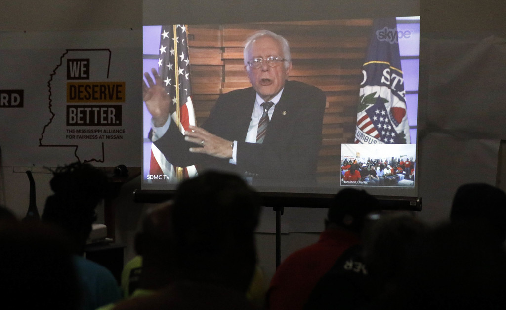 In this Tuesday, Aug. 1, 2017, photo, UAW members and Nissan employees participate in a videoconference with U.S. Sen. Bernie Sanders, I-Vt., and Demo...