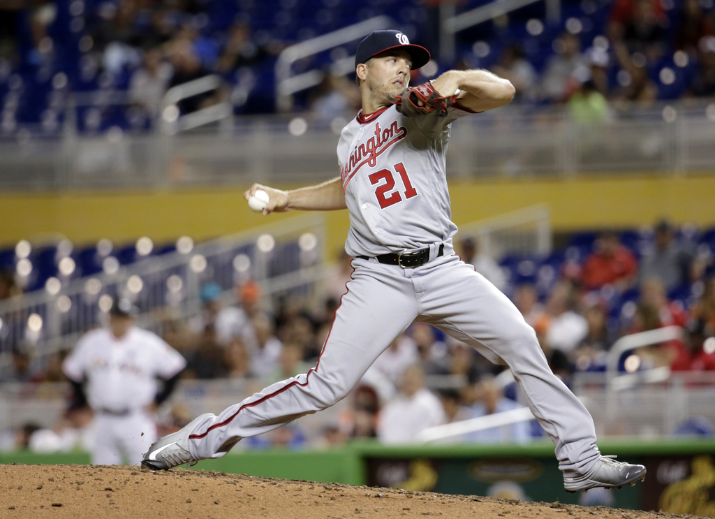 Washington Nationals relief pitcher Brandon Kintzler delivers during the eighth inning of the team's baseball game against the Miami Marlins, Wednesda...