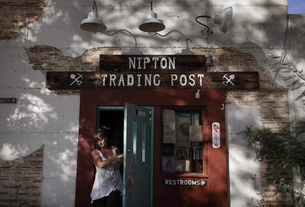 A woman leaves the Nipton Trading Post, Thursday, Aug. 3, 2017, in Nipton, Calif. American Green Inc., one of the nation's largest cannabis companies,...