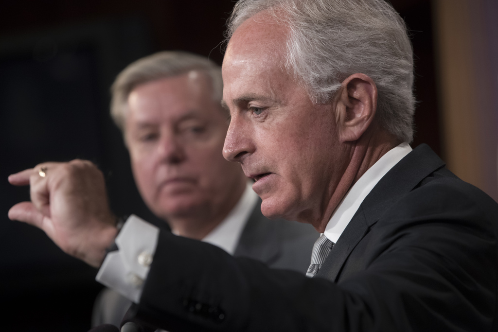Senate Foreign Relations Committee Chairman Sen. Bob Corker, R-Tenn., accompanied by Sen. Lindsey Graham, R-S.C., speaks with reporters on Capitol Hil...