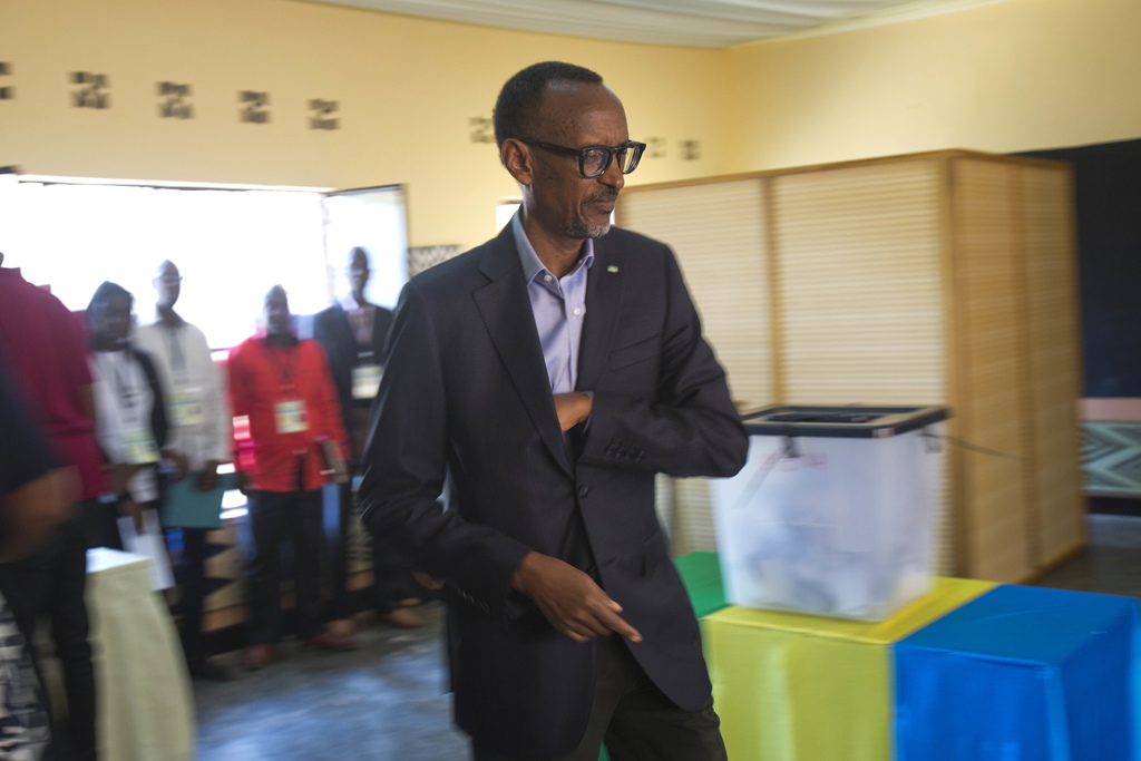 Rwandan President Paul Kagame arrives to cast his ballot in Rwanda's capital Kigali Friday Aug. 4, 2017 for the presidential elections in which he is ...