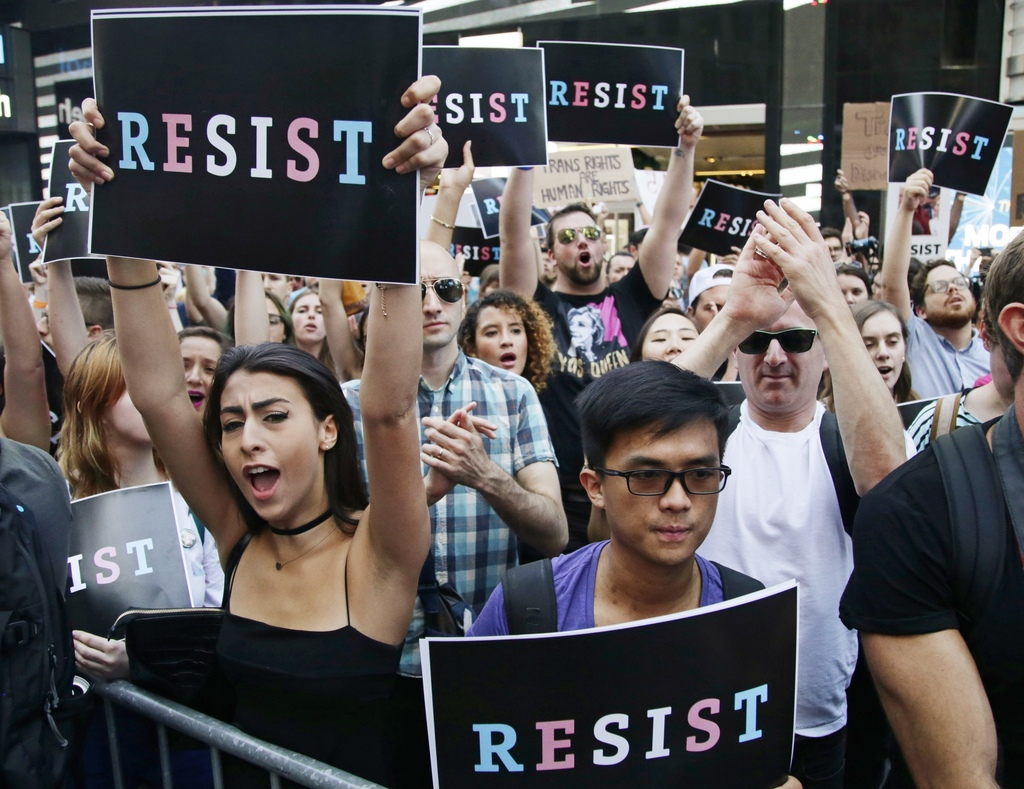 FILE - In this July 26, 2017, file photo, protestors attend a rally in New York City, to protest President Donald Trump's announcement of a ban on tra...