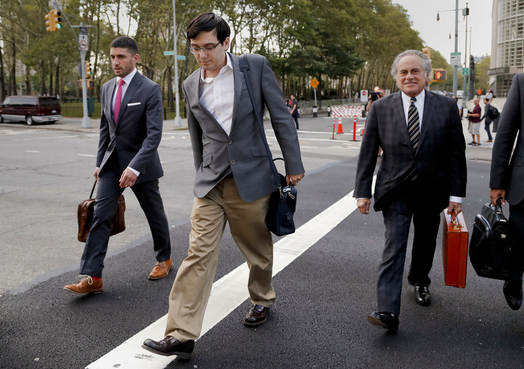 Former pharmaceutical company CEO Martin Shkreli, center, walks out of federal court with members of his legal team Thursday, Aug. 3, 2017, in New Yor...