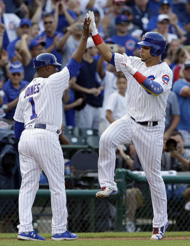 Chicago Cubs' Willson Contreras, right, celebrates with third base coach Gary Jones after hitting a three-run home run against the Arizona Diamondback...