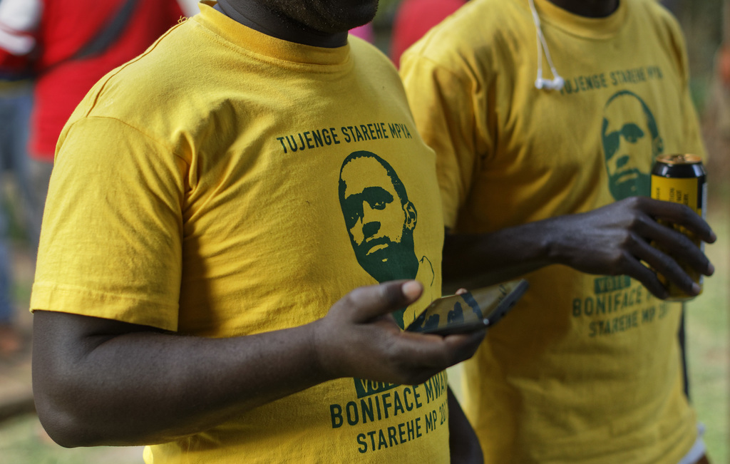 In this photo taken Saturday, July 29, 2017, supporters wear shirts showing former photojournalist, activist and now candidate for Member of Parliamen...