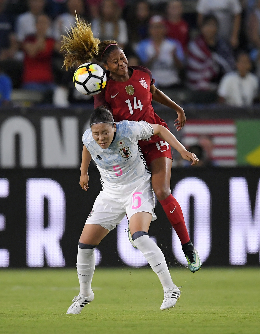 United States' Casey Short, top, and Japan's Madoka Haji try to head the ball during the first half of a Tournament of Nations soccer match, Thursday,...