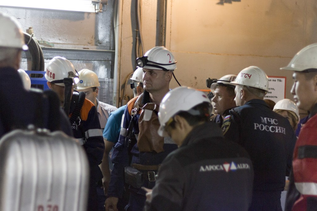In this handout photo taken on Friday Aug. 4, 2017, released by ALROSA diamond mining company shows a group of rescuers at the the Mir diamond mine, o...