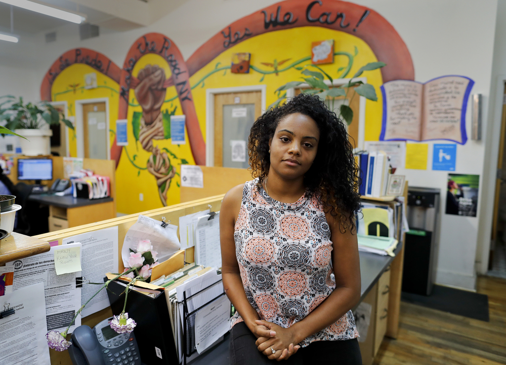 Yaritza Mendez, a citywide outreach coordinator for the non-profit Make the Road New York, stands for a photo at the organization's office, Thursday, ...