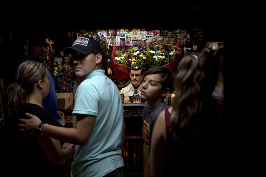 In this June 27, 2017 photo, a family from the United States visits the shrine of Jesus Malverde, the so-called narco-saint revered by many of Mexico'...
