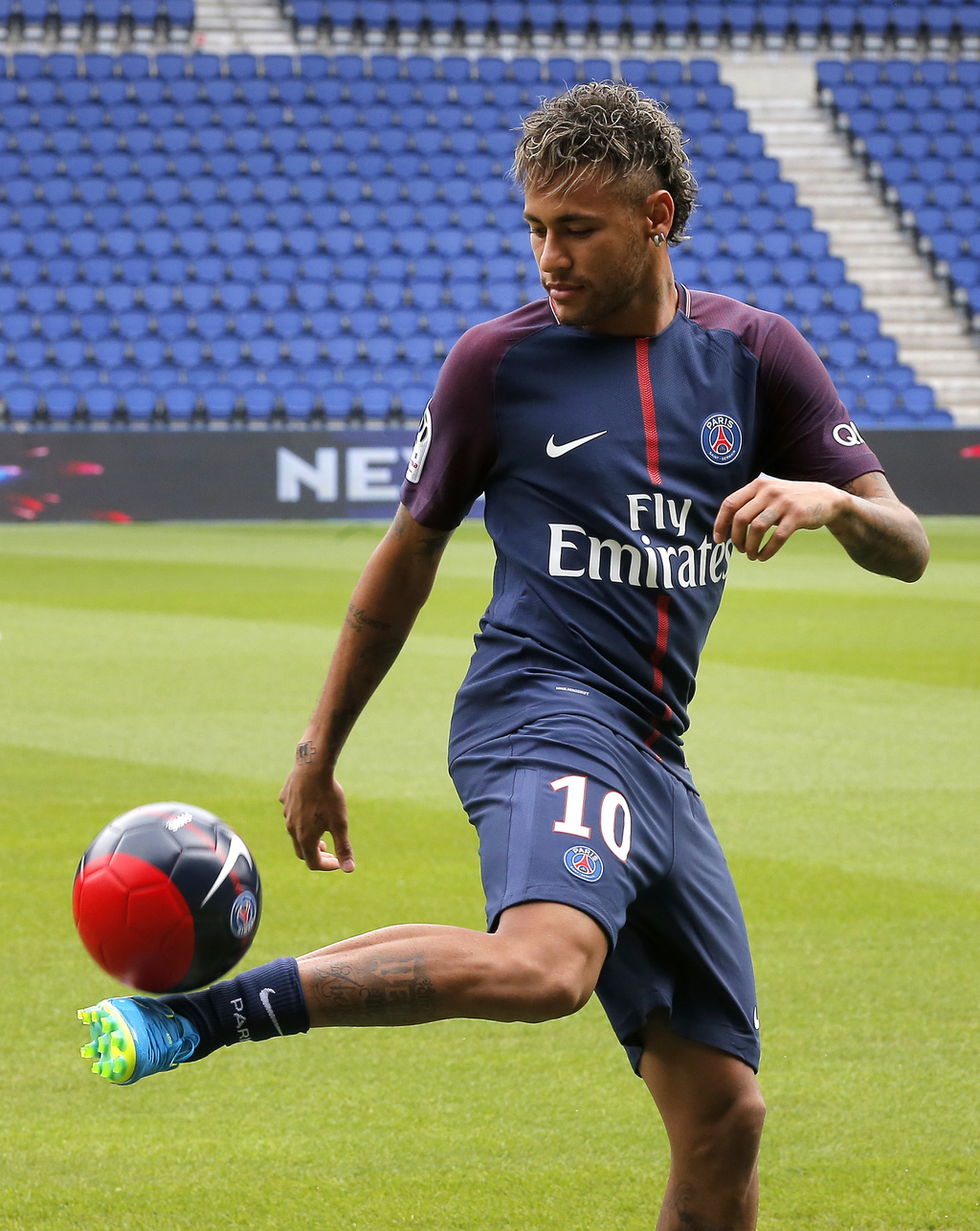 Brazilian soccer star Neymar controls the ball following a press conference in Paris Friday, Aug. 4, 2017. Neymar arrived in Paris on Friday the day a...