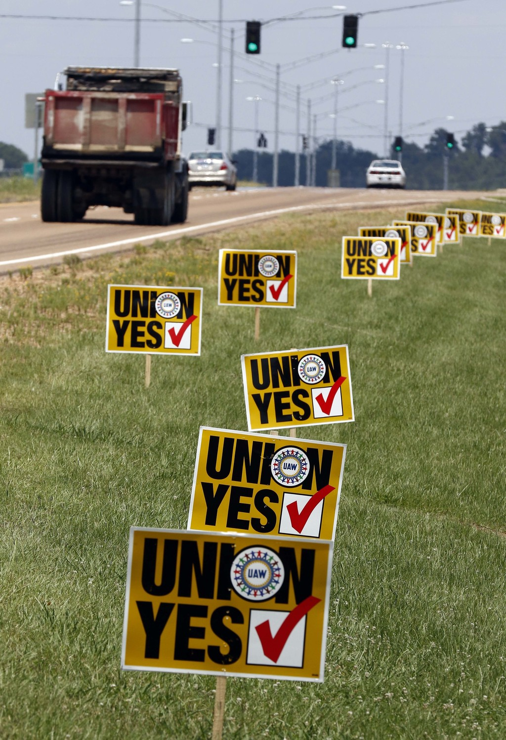 Pro union signs are displayed alongside the access road to the Nissan vehicle assembly plant in Canton, Miss., Thursday, Aug. 3, 2017. United Auto Wor...