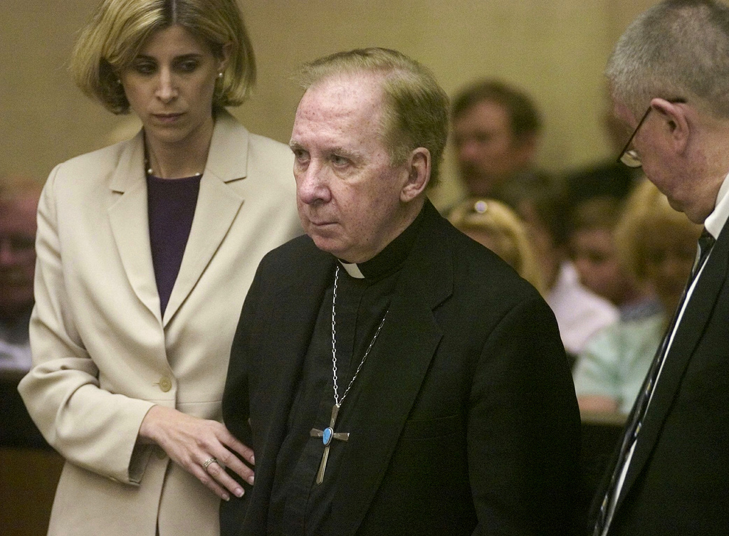 FILE - In this March 26, 2004, file pool photo, Bishop Thomas O'Brien, center, is flanked by attorneys, Melissa Berren, left, and Tom Henze, right, as...