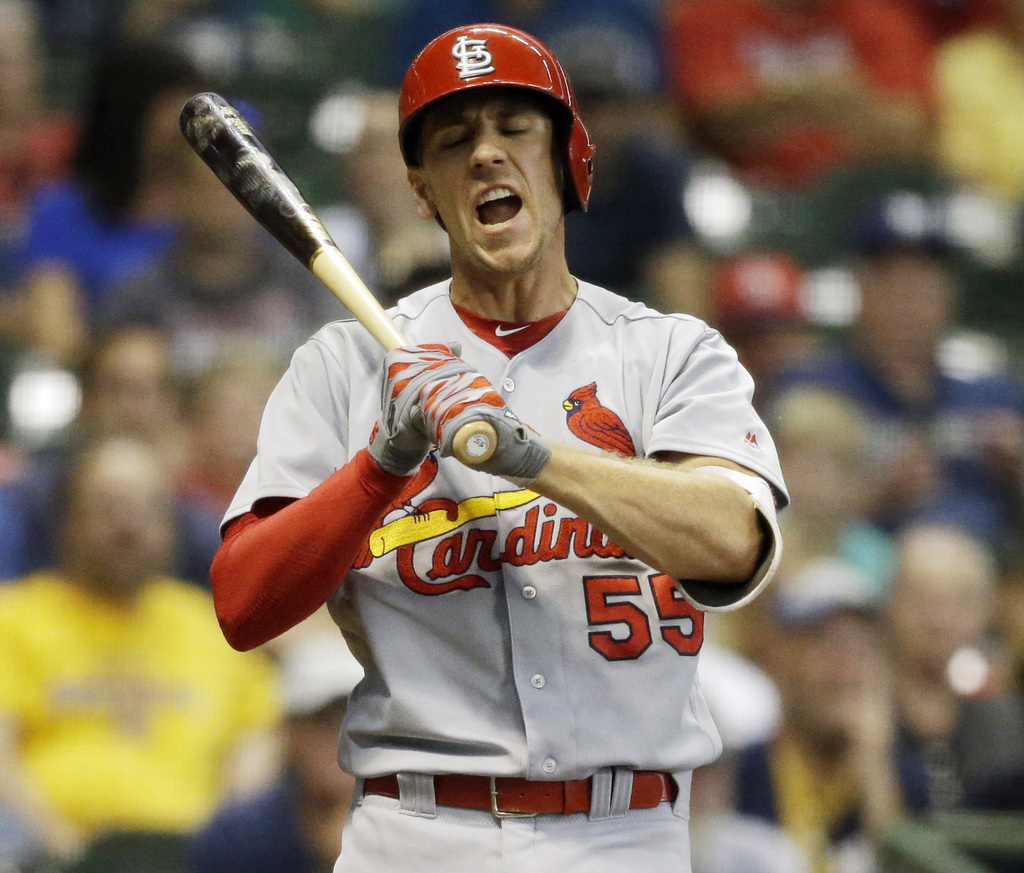 St. Louis Cardinals' Stephen Piscotty reacts after striking out against the Milwaukee Brewers during the seventh inning of a baseball game Thursday, A...