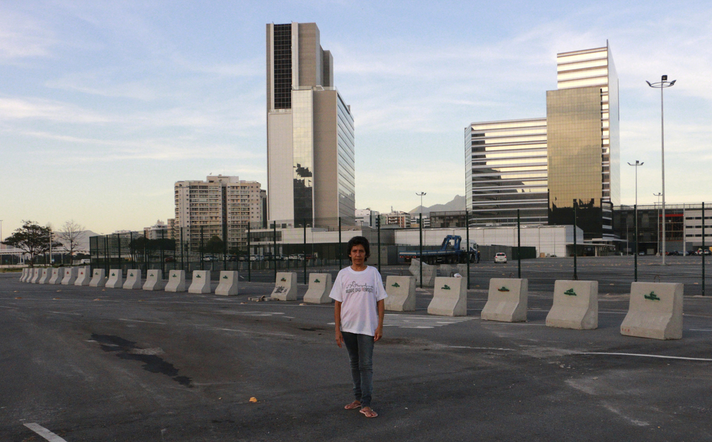 In this May 25, 2017, photo, Maria da Penha poses on the exact spot where her house used to be, in Rio de Janeiro, Brazil. She was evicted from Vila A...