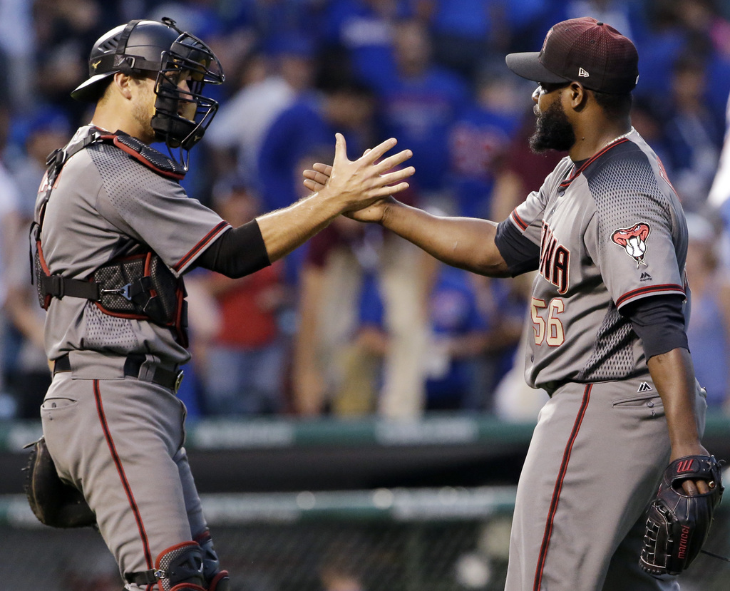 Arizona Diamondbacks closer Fernando Rodney, right, celebrates with catcher Jeff Mathis after they defeated the Chicago Cubs 10-8 in a baseball game T...