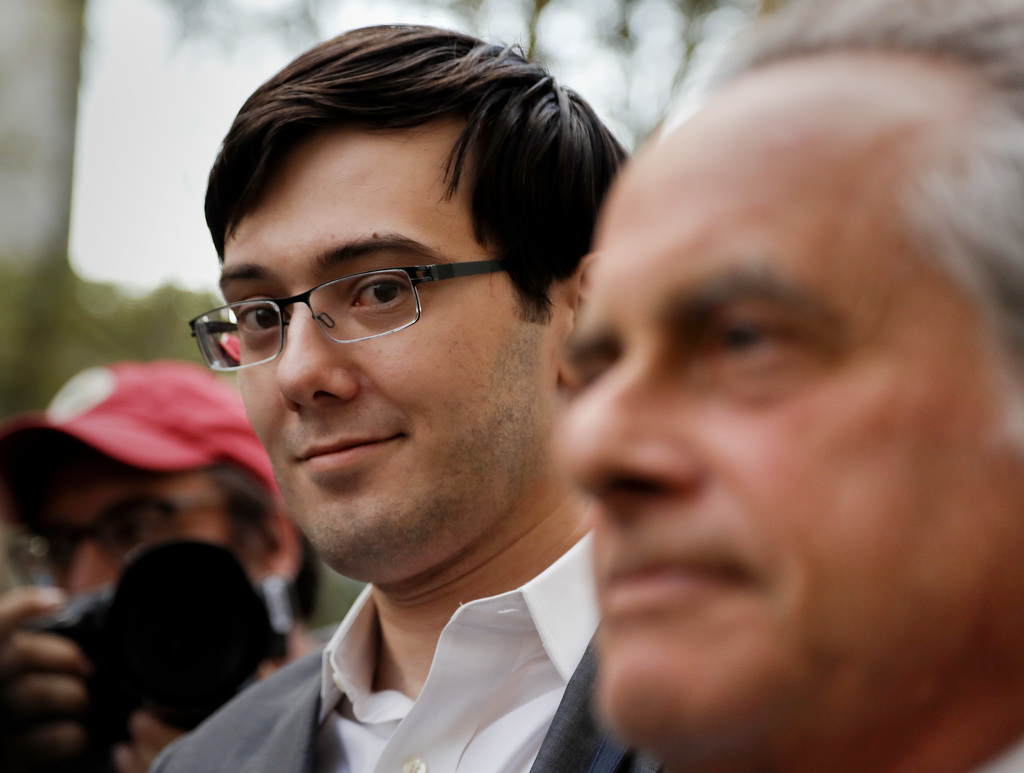 Former pharmaceutical company CEO Martin Shkreli, left, walks out of federal court with his attorney Benjamin Brafman, Thursday, Aug. 3, 2017, in New ...