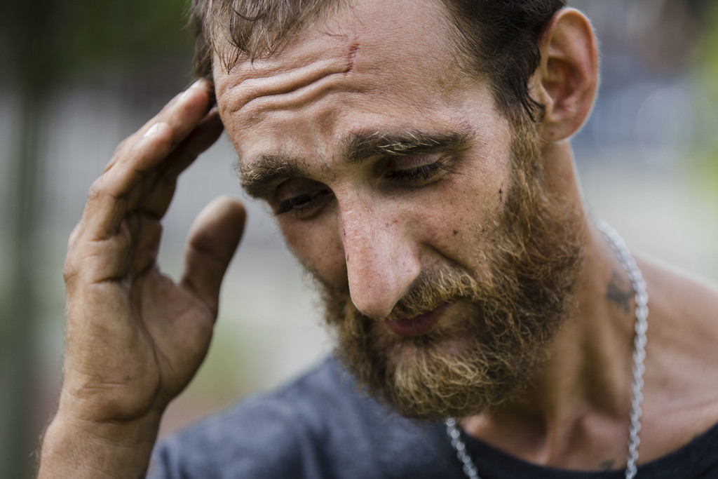 In this Monday, July 24, 2017 photo, Steven Kemp, who is addicted to heroin and is homeless, speaks with The Associated Press after meeting with a Phi...