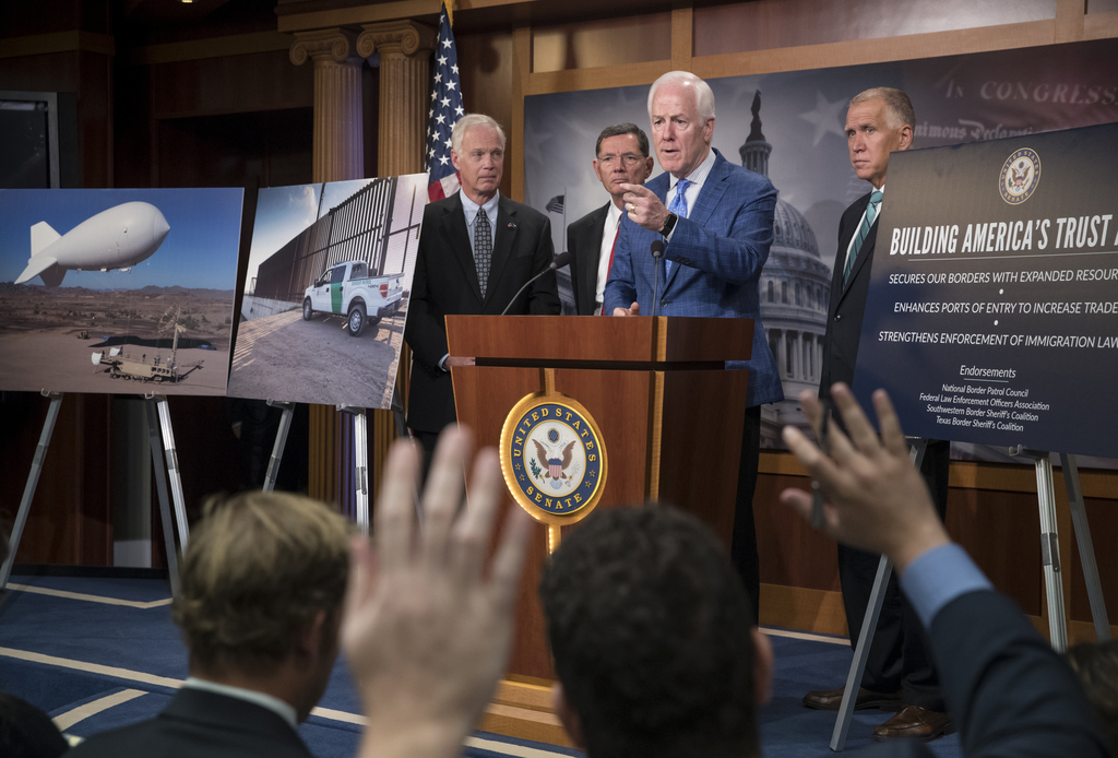 Senate Majority Whip John Cornyn of Texas, joined by, from left, Senate Homeland Security and Governmental Affairs Chairman Sen. Ron Johnson, R-Wis., ...