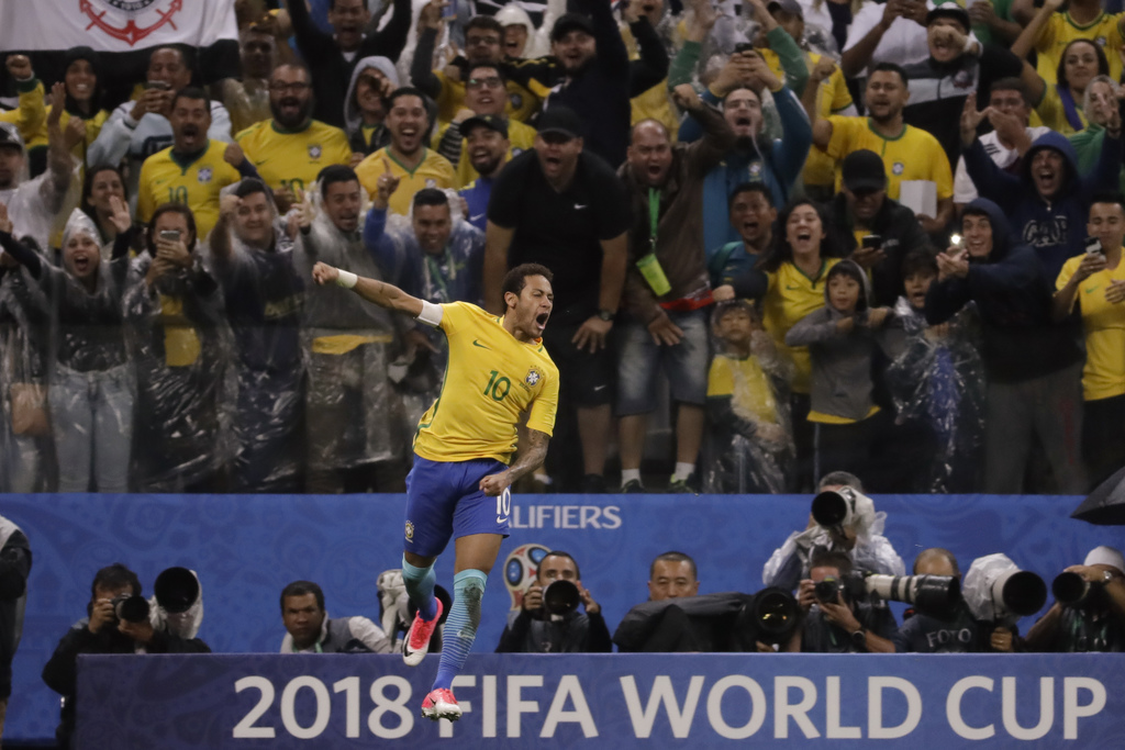 FILE - In this March 28, 2017 file photo, Brazil's Neymar celebrates scoring his side's 2nd goal against Paraguay during a 2018 World Cup qualifying s...